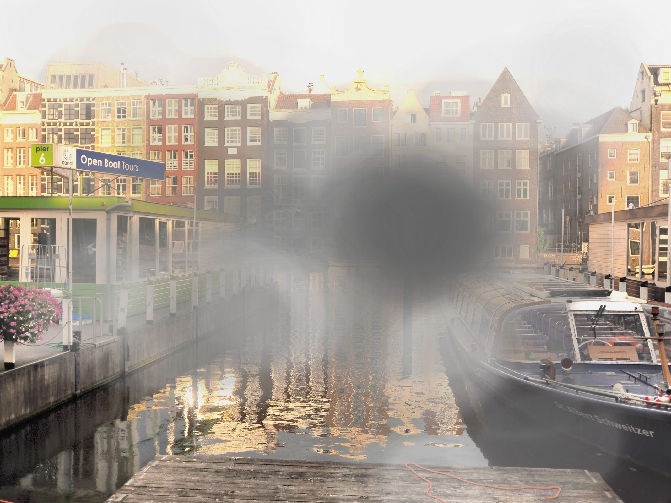 a picture of the city of Amsterdam. There are blind spots spread over the photo and it is vey light
